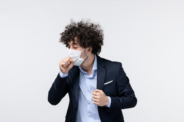 Top view of young male entrepreneur in suit and yawning on white background