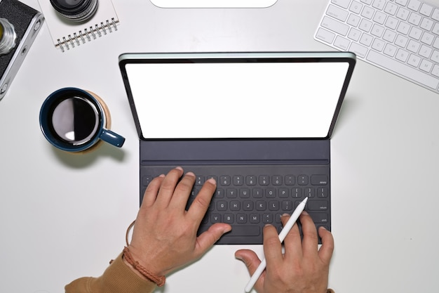 Top view of young man worker using on modern touchscreen tablet