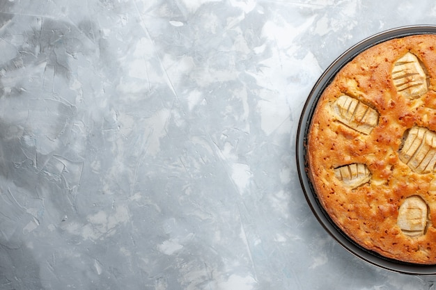 Top view yummy apple pie sweet and baked inside pan on the white desk