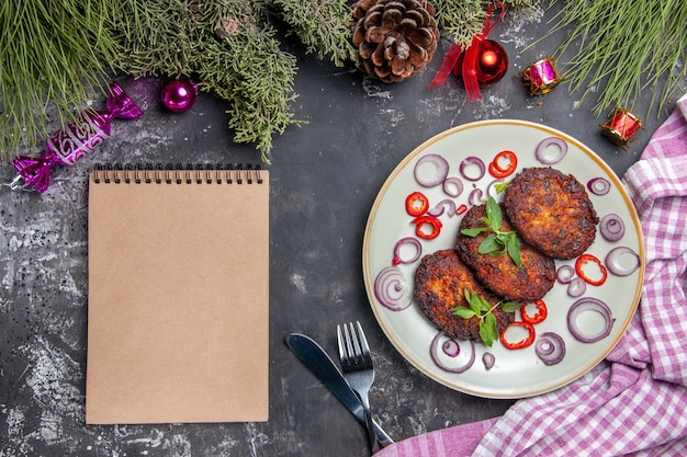 Top view yummy cutlets with onion rings on light-grey background meat dish meal photo