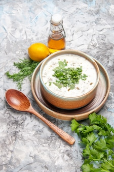 Top view yummy dovga yogurt soup with greens on the white soup dish milk dairy