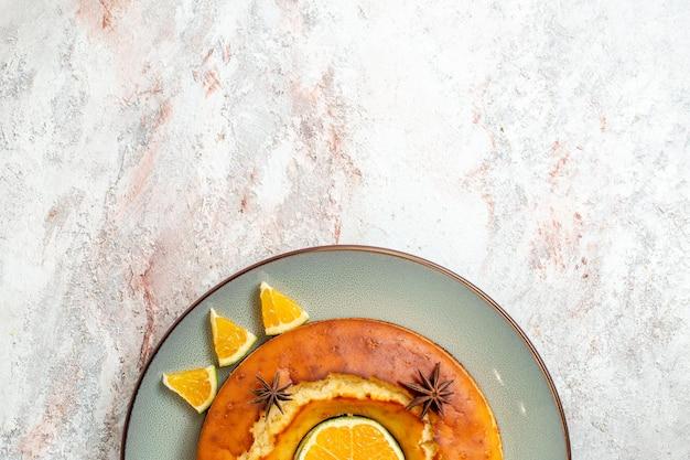 Top view yummy pie delicious dessert for tea with orange slices on white background fruit cake pie biscuit tea sweet dessert