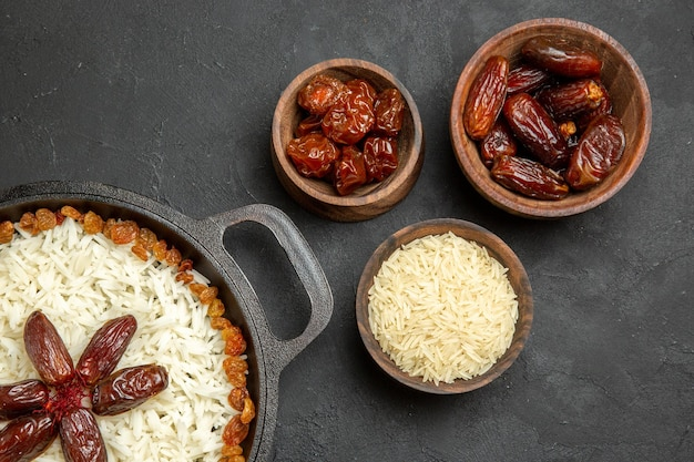 Top view yummy plov cooked rice dish with different raisins on dark background raisin rice dish food dinner oil