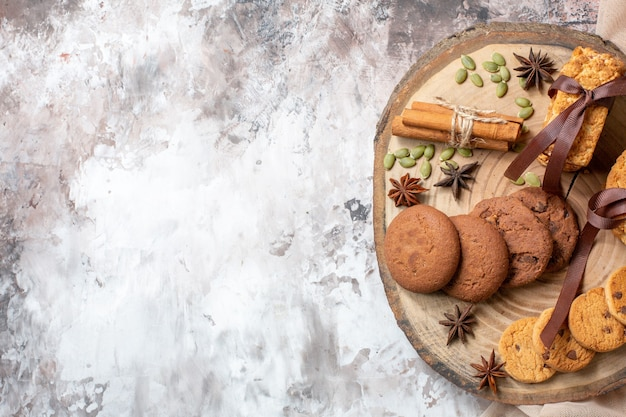 Top view yummy sweet biscuits on light table color cocoa sugar tea cookie sweet cake pie free space