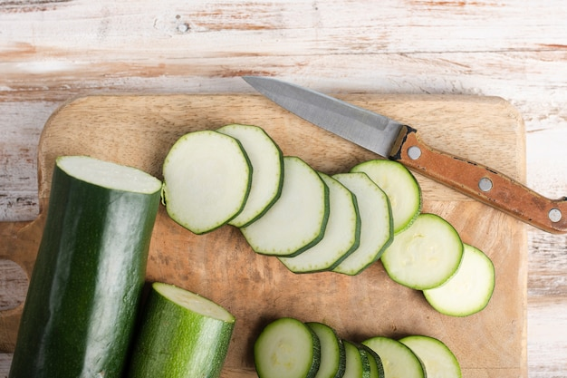 Top view zucchini slices and a little knife
