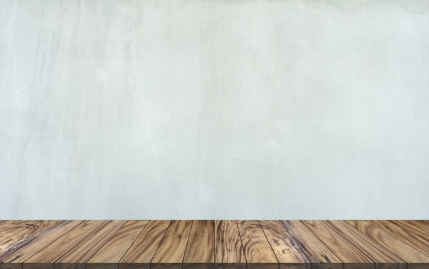 Top wood table perspective on gray cement wall background.