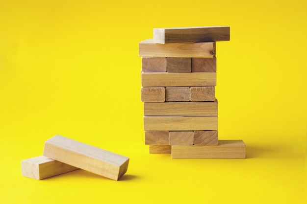 Top of wooden blocks over wooden block ,business and management concept.
