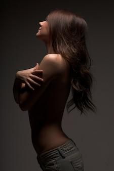Topless modest girl