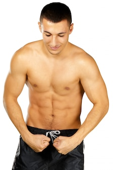 Topless young man bodybuilder posing isolated on white