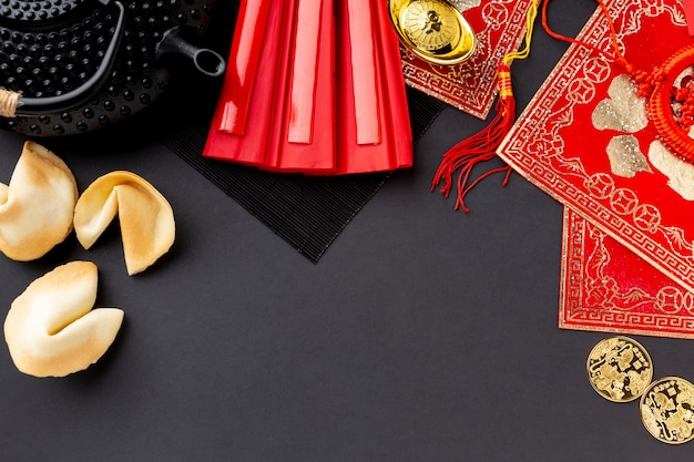Topview of fortune cookies and tea pot chinese new year