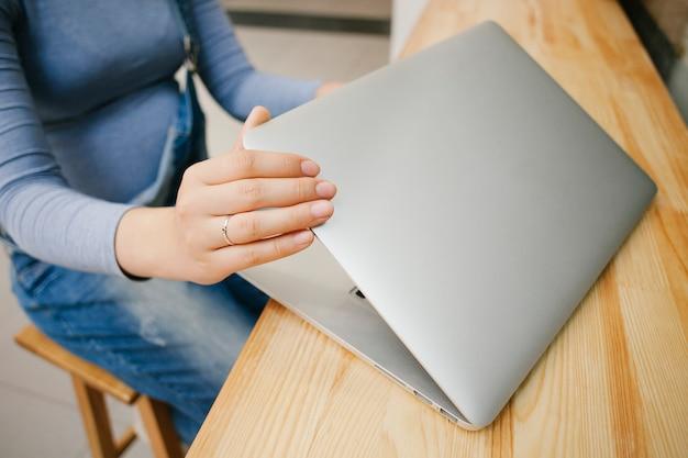 Topview woman opening laptop