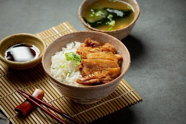 Toriyaki chicken on dark surface