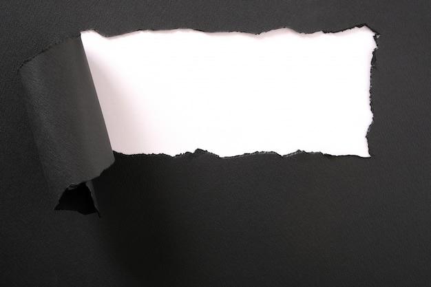 Torn black paper strip