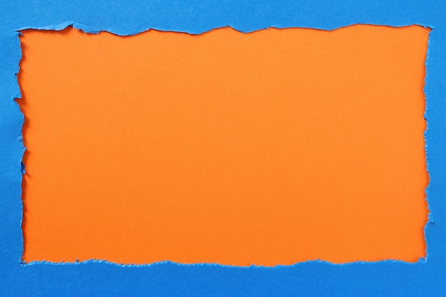 Torn blue paper orange background border frame
