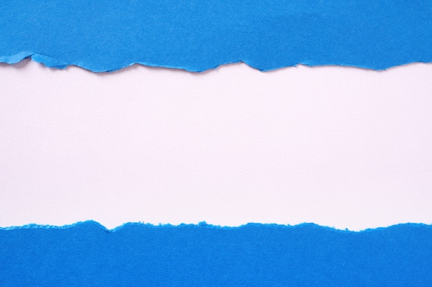 Torn blue paper strip straight edge border flat