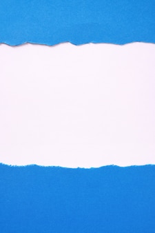Torn blue paper white background border frame vertical