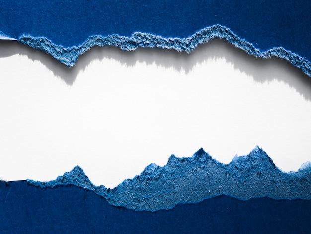 Torn blue paper