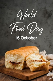 Torn bread filled with beef floss and mayonnaise on a wooden table with lettering world food day