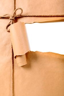 Torn brown paper package background