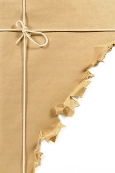 Torn brown paper parcel