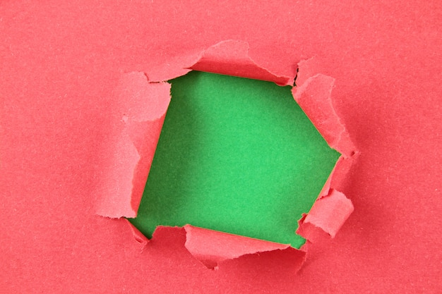 Torn colored paper, hole in the sheet of paper