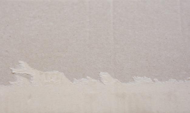 Torn corrugated fiberboard background