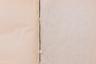 Torn line on an old two paper textured surface background