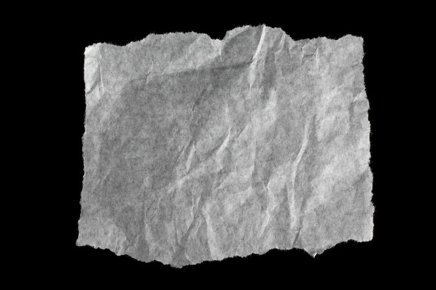 Torn paper isolated on black background.
