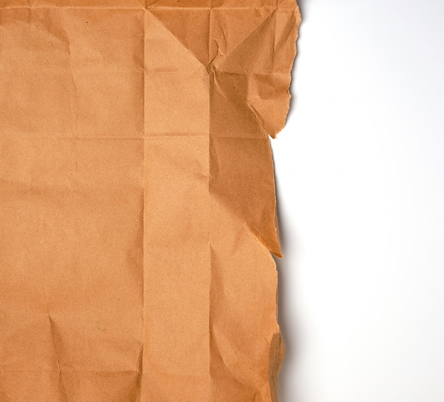 Torn piece of brown craft paper with torn edges