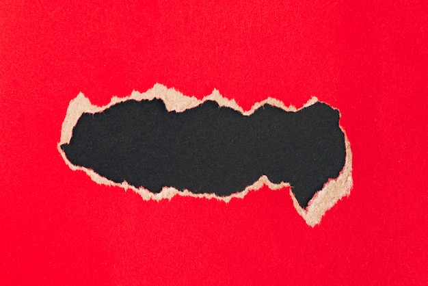Torn red paper background with copyspace