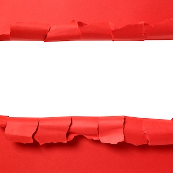 Torn red paper strip with white background copy space