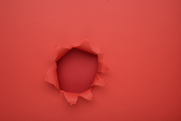 Torn red paper wall background. copy space aside for your advertising and offer or sale content.