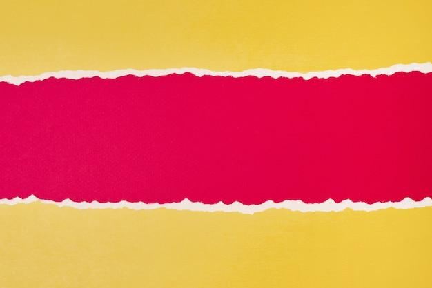 Разорванный край бумаги с копией пространства, красный и желтый цвет фона