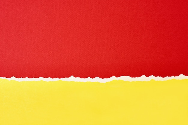 Torn ripped paper edge with a copy space, red and yellow color