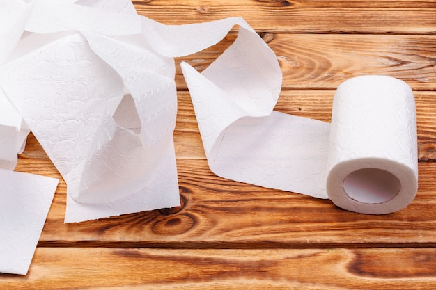 Torn toilet paper roll