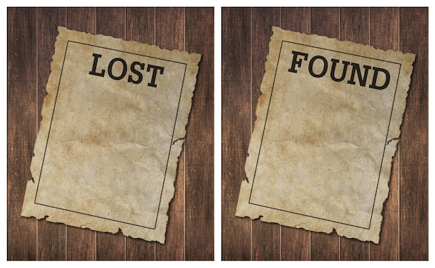 Torn wild west lost and found poster on old wooden wall