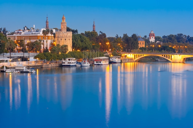Torre del oro at night in seville, spain