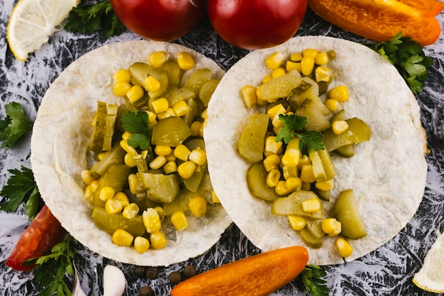 Tortilla bread with pickles and corn
