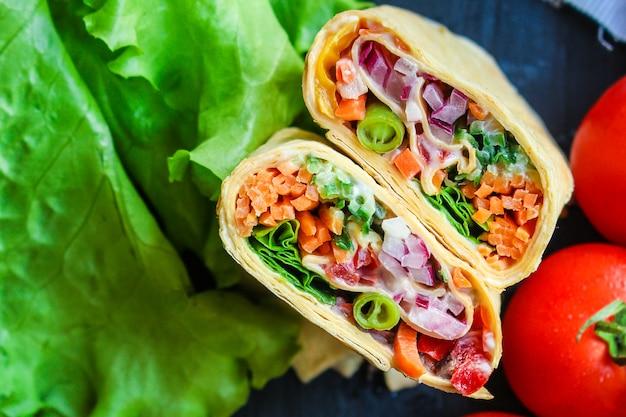 Tortilla or burrito wrap stuffing pita shawarma vegetables