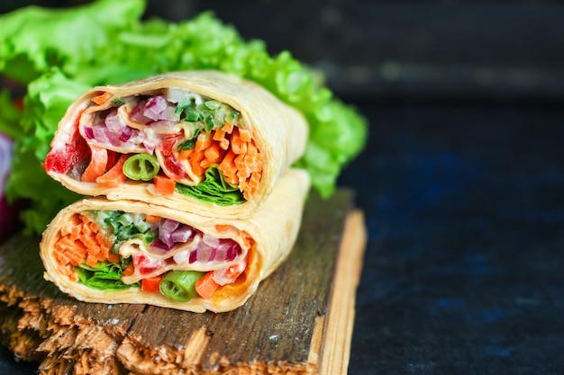 Tortilla burrito wrap stuffing vegetables lavash