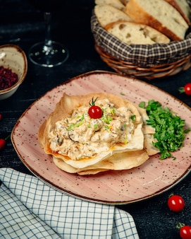 Tortilla filled creamy salad and topped with herbs