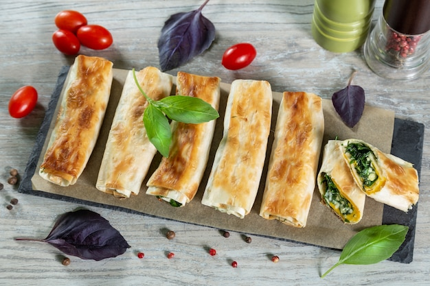 Tortilla rolls with cheese and greens