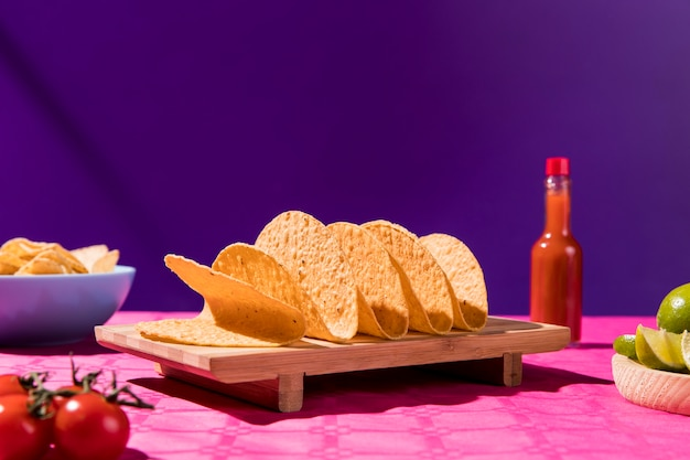 Tortilla and sauce bottle on table