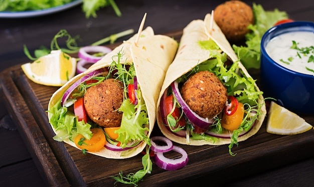 Tortilla wrap with falafel and fresh salad