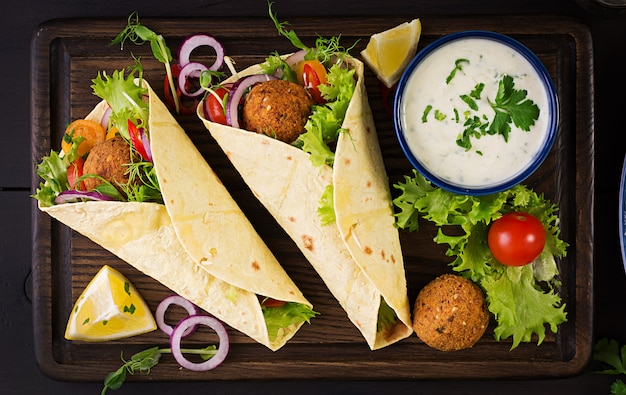 Tortilla wrap with falafel and fresh salad.