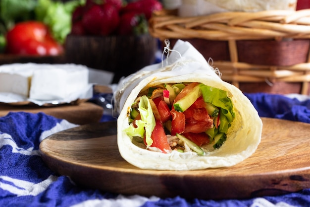 Tortilla wraps with roasted chicken and vegetables