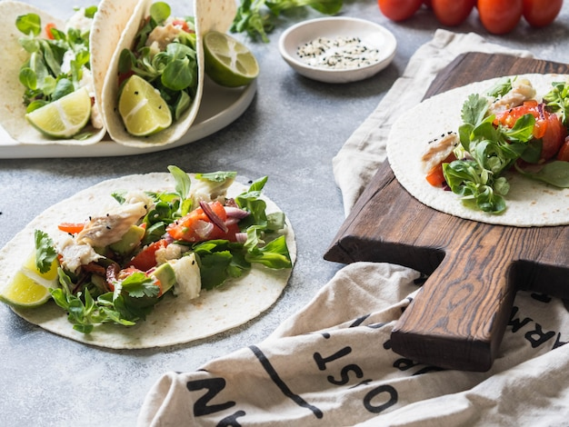 Tortillas with vegetables and white fish.