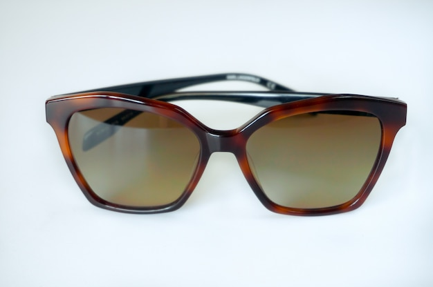 Tortoiseshell style sunglasses on white background