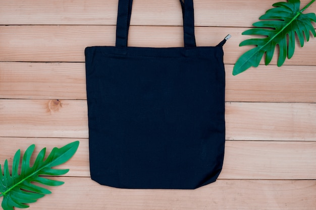 Tote bag canvas fabric cloth shopping sack mockup blank on wood backgroung.
