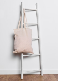 Tote bag on ladder indoors